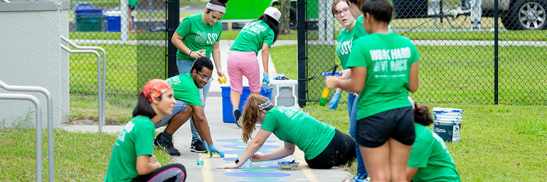 Students Helping Paint a Playground
