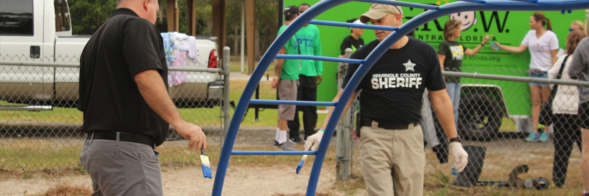 Seminole County Sheriff's Deputies Helping Paint a Playground